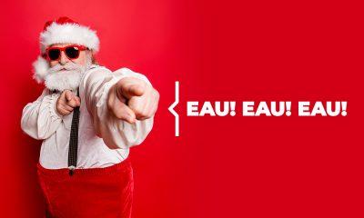 Plombier Expert | Père Noël cool avec lunettes de soleil sur fond rouge